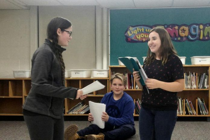 "Samuelle Weatherdon, Isaac Maker, and Emily Keller rehearse a scene from the new version of ""The Reluctant Dragon"" which Planet 12 Productions will be performing at area schools. (Photo: Derek Weatherdon / Planet 12 Productions)"