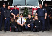 Scott Lawder, Brad Luby, Mark Sullivan, Amanda Nichols, Chief Snetsinger, Ed Venuk, Jaclyn Finney, Joe Cadigan, and Patrick Wayne of the Peterborough Professional Firefighters Association, pictured in 2016. Once again this year, the association will be donating money to the annual Salvation Army Toy Drive as well as to the Salvation Army hamper fund, and will help transport the toys and distribute the hampers. (Photo courtesy of Peterborough DBIA)
