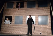 "In ""7 Stories"", a man stands on the ledge of a building contemplating suicide while an oddball cast of characters speaks to him through apartment windows. Pictured are Kelsey Morewood as Leonard, Lori Branch as Jennifer, and Drew Mills as The Man in Anne Shirley Theatre Company's production of Morris Panych's black comedy. (Photo: Sam Tweedle / kawarthaNOW.com)"
