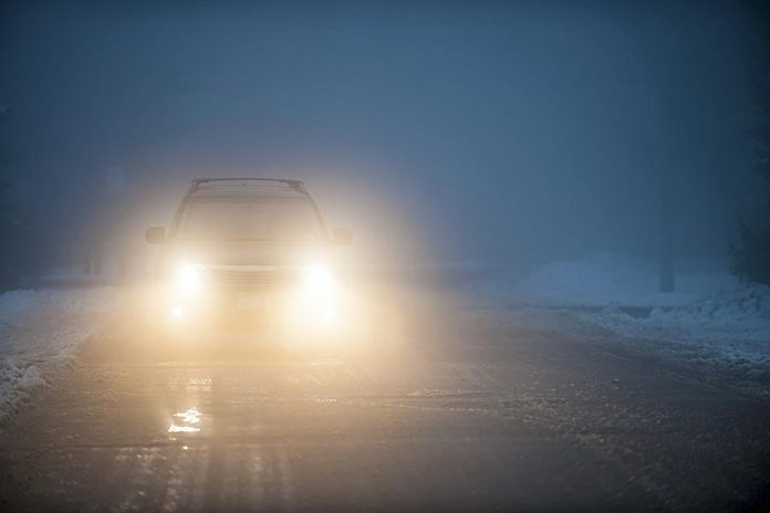 Car headlights in fog