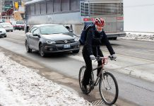 GreenUP's Jenn McCallum cycling to work in the winter. Winter weather can be chilly and windy, but why not try ditching the car and choosing a more healthy and active way to get to work? You can also save a lot of money by choosing active transportation instead of driving. (Photo: GreenUP)