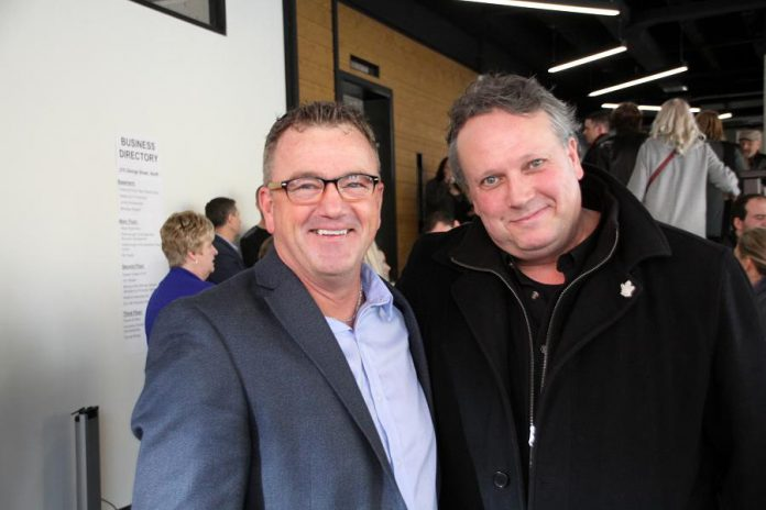 Jeff Day (left) with Peterborough DBIA executive director Terry Guiel at the Business Hall of Fame inductee announcement on January 10, 2018. Day says he resigned from his position at Community Futures Peterborough so he could run for Peterborough City Council in 2018. (Photo: Jeannine Taylor / kawarthaNOW.com)