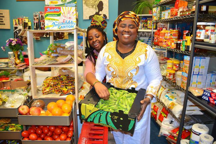 African Mission-Growth Market is bringing a taste of Africa to Peterborough. The Simcoe Street shop, run by Tokunbo Deborah Adebamiro (right), offers fresh produce like okra and yams. Tokunbo suggests blending the okra to make a soup. (Photo: Eva Fisher / kawarthaNOW.com)