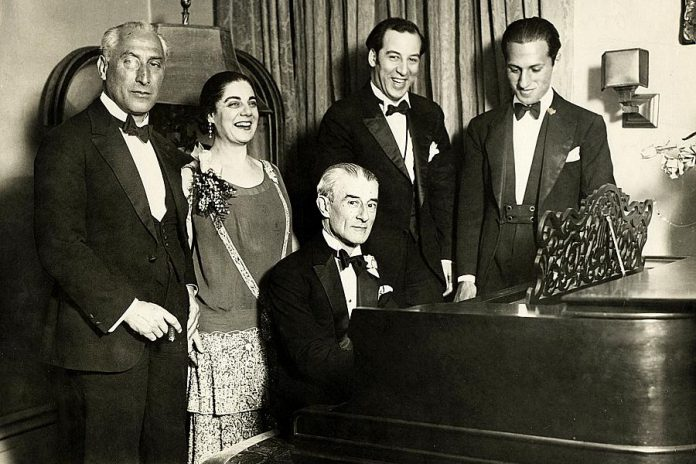 American composer George Gershwin (right) at a birthday party honoring Maurice Ravel (at the piano) in New York City on March 8, 1928. (Photo: Wikipedia)