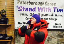 Deputy Police Chief Tim Farquharson trying on some winter weather gear at Wild Rock in downtown Peterborough. Farquharson will be spending a night outside on January 26, 2018 to raise awareness of the plight of the homeless, as well as raise money for YES Shelter for Youth and Families, Brock Mission, and The Warming Room. (Photo courtesy of Peterborough Cares)