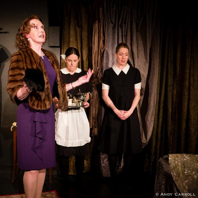 The mistress of the house (Sheila Carleton) dominating her live-in maids and sisters Claire (Lindsay Unterlander) and Solange (Kate Story). Genet's play is often considered symbolic of the class struggles of France in the early 20th century.  (Photo: Andy Carroll)