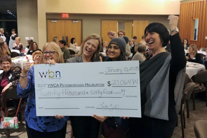 Anne Arnold and Corinna Campbell of YWCA Peterborough Haliburton with Sana Virji and Lori McKee of the Women's Business Network of Peterborough celebrating the donation of $20,064.84 to support the YWCA Crossroads Shelter. The funds were raised at WBN's annual fundraising gala in December. (Photo: Paula Kehoe / WBN)
