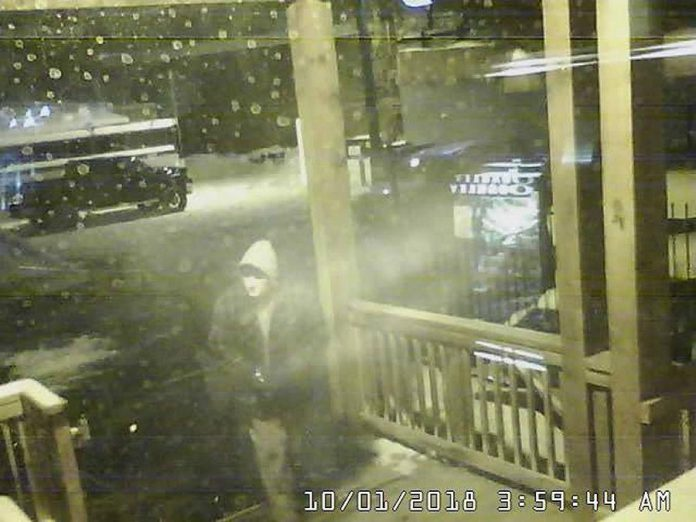One of the three men who broke into the rear entrance of Wild Rock in downtown Peterborough before stealing Canada Goose parkas. (Photo: Wild Rock / Facebook)