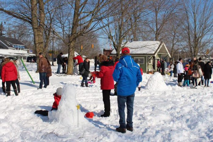 "Attendees at last year's FrostFest enjoyed hot chocolate and homemade cookies donated by local businesses and volunteers, while Impact 32 volunteers ran fun games with prizes for every child, and mascot ""Bobbie Constellation"" circulated among the crowds. (Photo courtesy of Impact 32)"