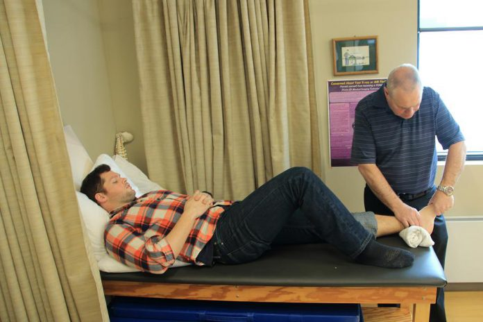 Adaptive Health Care Solutions' physiotherapists use a comprehensive treatment approach to assist you after an injury, accident, or surgery. Pictured is physiotherapist John Cook, B.Sc., P.T. treating a client.  (Photo: Adaptive Health Care Solutions)