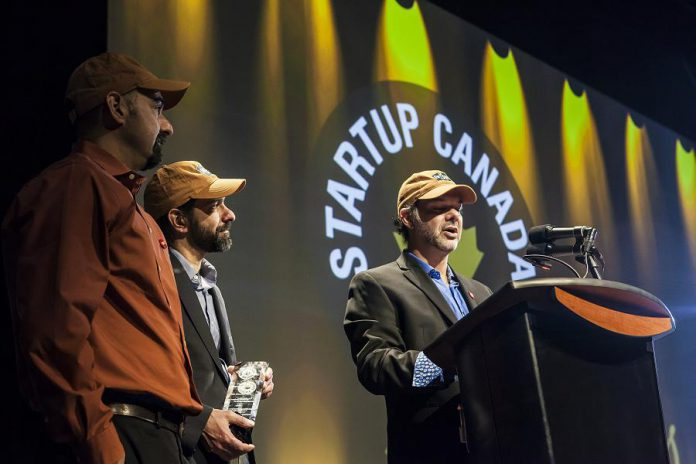 Entomo Farms accepting their Sustainable Development award at the 2015 Ontario Regional Startup Canada Awards. (Photo: Startup Canada)