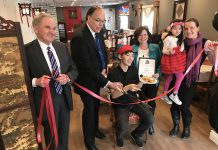Peterborough Mayor Daryl Bennett cutting the ribbon at the official grand opening of Dragon Yan at 422 Braidwood Avenue in Peterborough on February 16, 2018, whose owner Ron Kam (seated) also made a donation to the New Canadians Centre. Also pictured are city councillors Dan McWilliams and Lesley Parnell, Kam's daughter Heidi, and Hajni Hos, executive director of the New Canadians Centre. (Photo: Daryl Bennett / Twitter)