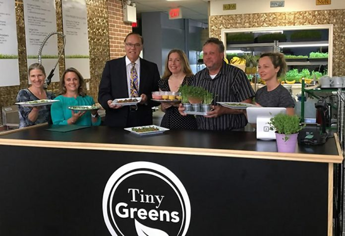 Tiny Greens owner Tina Bromley (centre) with Peterborough Mayor Daryl Bennett and Peterborough DBIA executive director Terry Guiel. Bromley launched her store in downtown Peterborough after winning the inaugural 2017 Win This Space competition last February. (Photo: Tiny Greens)
