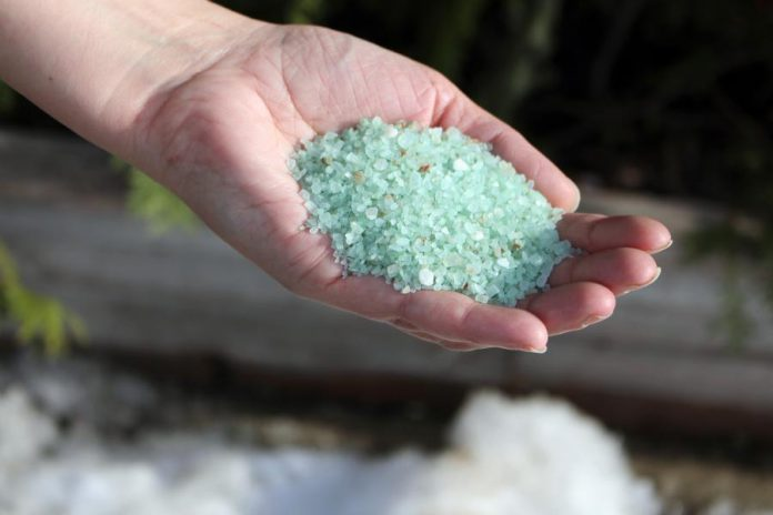Look for ice-melting alternatives to salt that contain magnesium chloride, which is gentler on vegetation, concrete, water, and floors. It's not corrosive and is completely safe to handle with bare hands, so it's safer around children and pets, too. You also need to use less of it to accomplish the same job as salt. (Photo: Karen Halley)