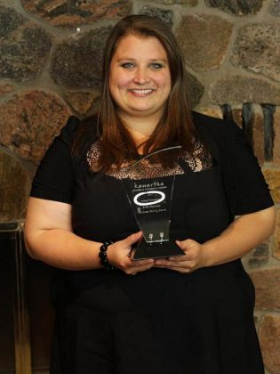 Erin McLean of McLean Berry Farm with her 2017 Young Professional Award from the Kawartha Chamber of Commerce & Tourism.