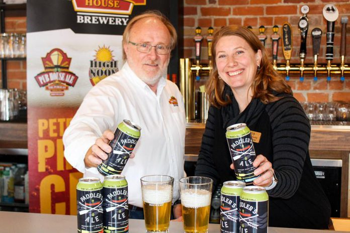Marty Laskaris, co-founder and president of Publican House Brewery, with Carolyn Hyslop, general manager of The Canadian Canoe Museum. Publican House Brewery has raised $7,289 for the museum through sales of its Paddler's Ale. (Photo courtesy of The Canadian Canoe Museum)