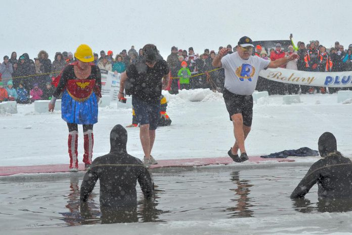 """Wonder Woman"" (Andi van Koeverden, President of the Rotary Club of Peterborough), ""Batman"" (Trevor Copeland, President of BEL Rotary), and ""Rotary Man"" (Len Lifchus, President of the Rotary Club of Peterborough Kawartha) take the Polar Plunge at the annual BEL Rotary event on February 4, 2018. The event raised more than $20,000 for local charities and organizations, including $1,765 for The Warming Room in Peterborough raised through Lifchus' participation. (Photo: Lynne Chant / Rotary Club of Peterborough Kawartha)"