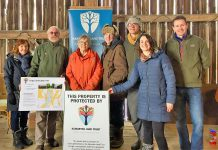 Property owner Mieke Schipper (third from left) has donated a conservation easement agreement to the Kawartha Land Trust (KLT) to protect the family's 100-acre Pigeon Lake property, home of the Gamiing Nature Centre, in perpetuity. Also pictured (left to right): Eva Kennedy, KLT Board of Directors; Ian Attridge, KLT Volunteer; Amy Elliott, Gamiing Nature Centre Board of Directors; Thom Unrau, KLT Land Stewardship Coordinator; Tara King, KLT Development Coordinator; and Mike Hendren, KLT Executive Director. (Photo courtesy of Kawartha Land Trust)