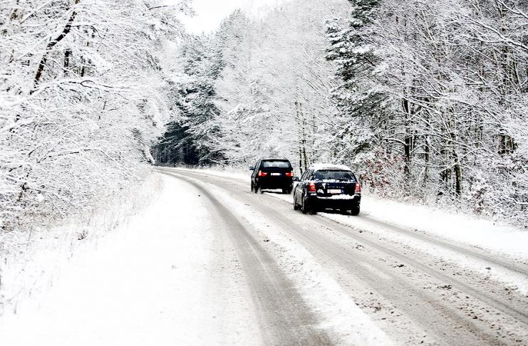 Two cars on a snow-covered road