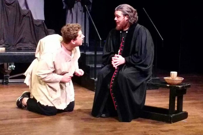 """Brandon Remmelgas as Quasimodo and Rowan Lamoureux as Claude Frollo in the Anne Shirley Theatre Company production of """"The Hunchback of Notre Dame"""", a musical based on Victor Hugo's 1831 novel and the 1996 Disney animated film. The production runs from March 9 to 17 at Peterborough's Market Hall. (Photo: Sam Tweedle / kawarthaNOW.com)"""