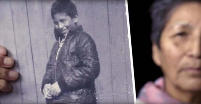 Pearl Achneepineskum holds a photo of her brother Chanie Wenjack in this screenshot from a Heritage Minute released in 2017 by Historica Canada.