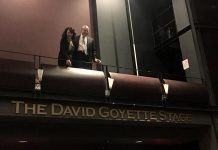David Goyette with his wife Victoria Pearce above the sign at Showplace Performance Centre proclaiming The David Goyette Stage. Pearce and Goyatte, who already has the naming rights for the theatre's green room from an earlier donation, made a 10-year financial contribution non-profit performance venue to secure the naming rights for the stage located in the main theatre, allowing the non-profit venue to purchase a new lighting console. (Photo: Showplace Performance Centre)