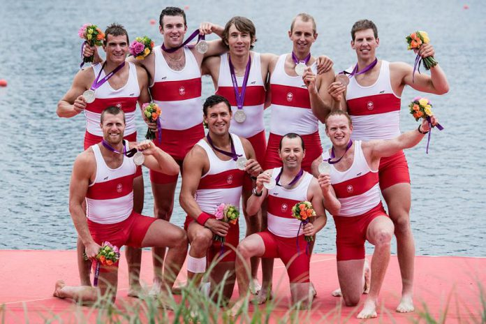 Jeremiah Brown (right) and other members of Team Canada's men's eights rowing team with their silver medals following the 2012 Summer Olympics in London. (Photo: Team Canada / Canadian Olympic Committee)