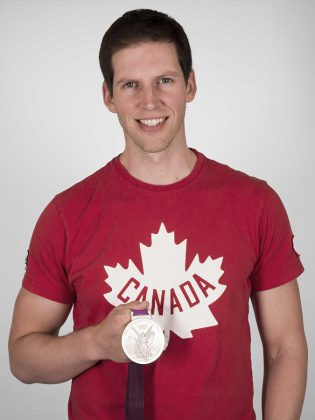 "Jeremiah Brown with his Olympic silver medal. You can meet Brown and try on his silver medal at the Peterborough launch of his new book ""The 4 Year Olympian"" on March 31st at Chapter's  Brown will be donating a portion of proceeds of book sales at theat event to the Peterborough Rowing Club. (Photo courtesy of Jeremiah Brown)"
