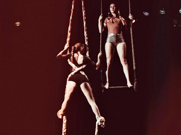"Opal (Jen) Elchuk and Kayla Stanistreet in ""Captive:ated"", one of 13 new works being presented by Public Energy at Emergency #22 from March 22 to 24, 2018. A twist on the Grimms Brothers' Rapunzel tales, ""Captive:ated"" is a work of circus theatre employing trapeze and braided silks and will be performed at Market Hall Performing Arts Centre on March 22 and 23. (Photo: Erin Hanes Photography)"