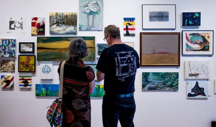 At the 50/50 art draw, the emcees will draw a ticket at random and call out a number, and the ticket holder with that number will choose a piece of art off the wall. Profits from all art sales are shared between our participating artists and Artspace. (Photo: Matt + Steph)