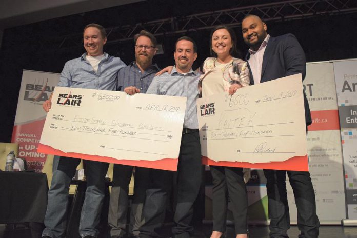 Percheron Plastic Inc. (which produces FireStraw fire starters) and virtual and augmented reality start-up Kavtek accepting their cash prize of $6,500 each at the final pitch event of the 2018 Bears' Lair Entrepreneurial Competition, held on April 18, 2018 at The Venue in downtown Peterborough. Along with the cash prize, the winners receive in-kind prizes, all donated by the 2018 Bears' Lair sponsors. (Photo courtesy of Scott Howard)