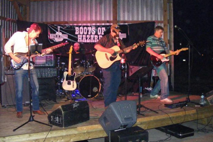"""Country rock band Boots of Hazard is Dennis Carmichael (bass/vocals), Gavin Gartshore (drums/vocals), Craig Stacey (guitar/vocals), and Dennis Carmichael (guitar/vocals). The band released its first single """"Muddy Water"""" in July 2017 and is working on a full-length album for release next year. (Photo courtesy of Boots of Hazard)"""