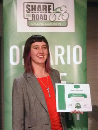 B!KE Executive Director Tegan Moss with her award from the Ontario Bike Summit. (Supplied photo)