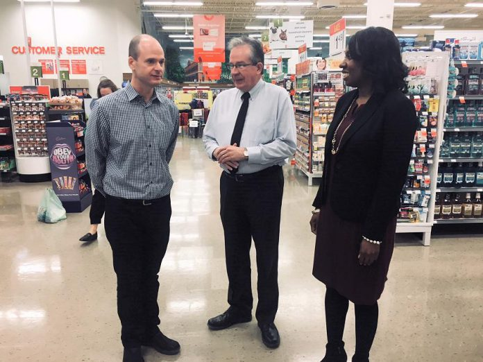 Dave Morello (left), co-owner of Morello's Independent Grocer, gave a tour of his store to Peterborough MPP Jeff Leal, Minister Responsible for Small Business, and MPP Mitzie Hunter, Minister of Advanced Education and Skills Development, at the Employing Young Talent Incentive announcement on April 3, 2018. (Photo: Paul Rellinger / kawarthaNOW.com)