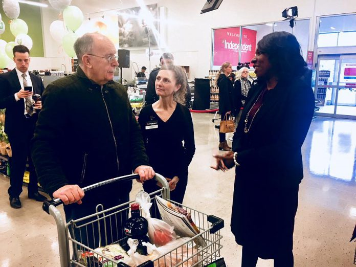 MPP Mitzie Hunter, Minister of Advanced Education and Skills Development, and Kim Morello, co-owner of Morello's Independent Grocer, chat with a store customer at Tuesday's Employing Young Talent Incentive announcement.  (Photo: Paul Rellinger / kawarthaNOW.com)