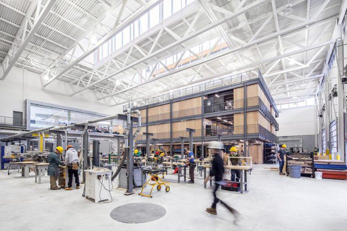 The Skills Arena and the Kube are flexible and integrated learning spaces at Fleming College's Kawartha Trades and Technology Centre (KTTC). The American Institute of Architects has recognized KTTC, designed by Perkins+Will, with a 2018 Education Facility Design Award. (Photo: Scott Norsworthy)
