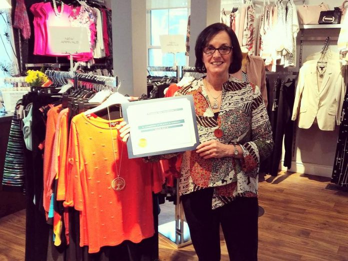 Style Boutique, a women's clothing store in Bridgenorth, recently celebrated its 10th year in business. Owner Diana Carter poses with a congratulatory plaque delivered by Selwyn Township Mayor Mary Smith. (Photo: Style Boutique / Facebook)