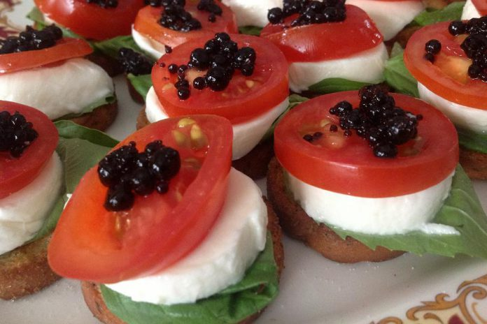 Fresh mozzarella with tomato, basil, and balsamic pearls. (Photo: Shari Darling)