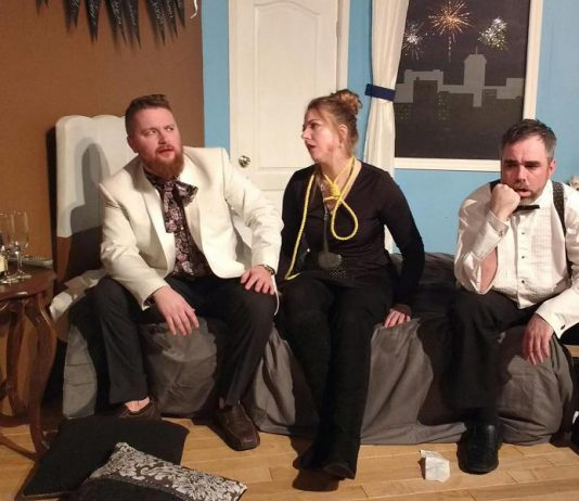 """Ben Whyte as Mitchell, Holly English as Arlene, and Seamus McCann as Paul in the black comedy """"Murder at the Howard Johnson's"""", running April 20 and 21 and April 27 and 28 at Lindsay Little Theatre. (Photo: Sam Tweedle / kawarthaNOW.com)"""