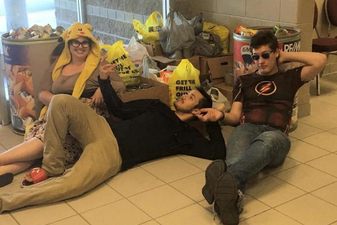 Pop Culture Canada staff relax after collecting 1,115 pounds of donated food for the local food bank at Peterborough Comic Con in September 2017. (Photo: David Wyldstar)