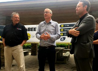 Peterborough Regional Farmers' Network president Neil Hannam (centre), flanked by Peterborough DBIA executive director Terry Guiel and AON president and CEO Brad Smith, announced Tuesday (May 22) that the group's new farmers' market will be located in the Citi-Centre Courtyard off Aylmer Street between Charlotte and King streets in Peterborough. The Peterborough Regional Farmers' Market opens June 9, 2018 and will continue each Saturday morning into the fall. (Photo: Paul Rellinger / kawarthaNOW.com)
