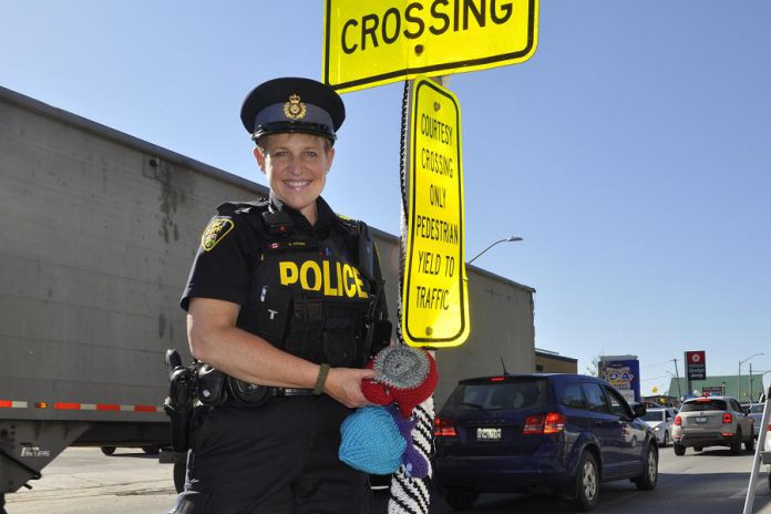 Sergeant Sandy Adams from the Bancroft OPP Detachment participated in the yarn bomb. (Photo courtesy of Knittervention)