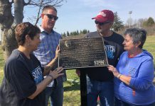 "A plaque honouring the late Bill ""Mr. Slo-Pitch"" Bowers was unveiled Wednesday morning (May 2) in Bowers Park off Brealey Drive in Peterborough. Among those remembering Bowers' milestone contributions to the game at the local, provincial and national were (from left) City of Peterborough recreationist Terry Lynn Johnston, Bowers' son Dan (who travelled from North Dakota for the dedication), and his close friends and Peterborough Slo-Pitch Association colleagues Bob and Maureen Lewis. (Photo: Paul Rellinger / kawarthaNOW.com)"