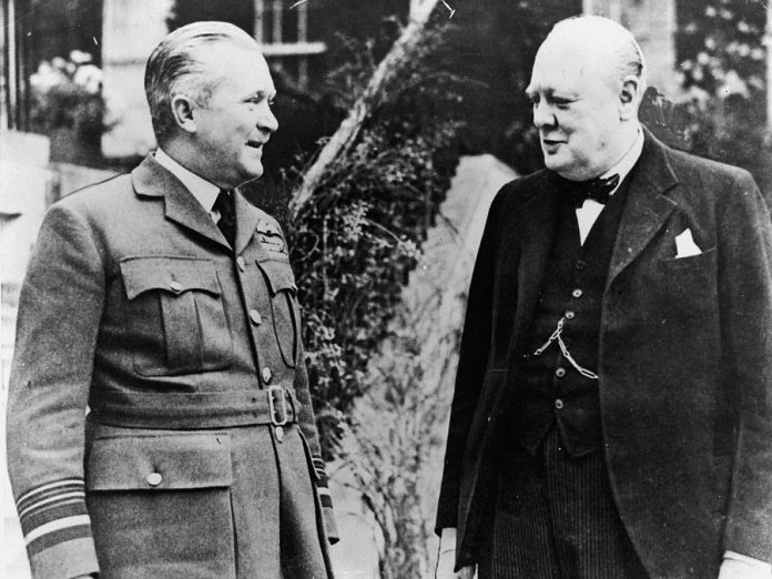 "Air Vice Marshal William ""Biily"" Bishop chats with British Prime Minister Winston Churchill in England in 1940. (Photo: DND Archives, PL-091)"