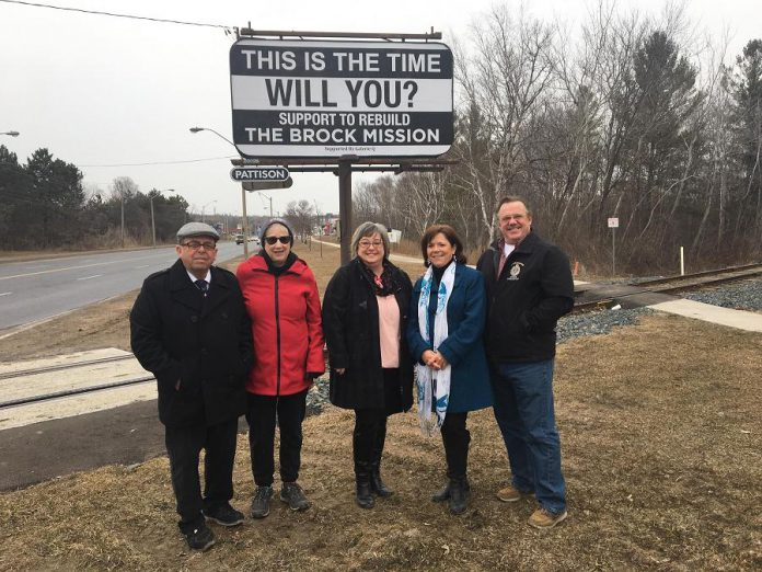 In March, Galerie Q donated this billboard on The Parkway to raiseg awareness of the Brock Mission rebuild project. Pictured are Brock Mission board members Dennis Shebib and Carol Rennick, Galerie Q PR manager Christine McCulloch, Councillor Lesley Parnell and her husband Don. (Photo courtesy of Lesley Parnell)