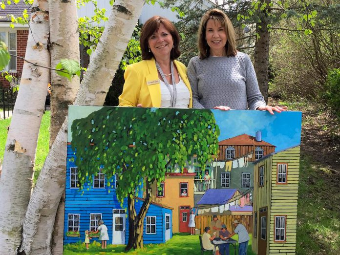 City of Peterborough councillor Lesley Parnell with Meg Seabrook, the winner of a painting by Quebec artist Yvon Lemieux donated by Cavan art gallery Galerie Q to support the rebuild of Brock Mission. Paying it forward, Seabrook has decided to donate the painting, valued at $7,500, to hang in the new Brock Mission when it is completed. (Photo courtesy of Lesley Parnell)