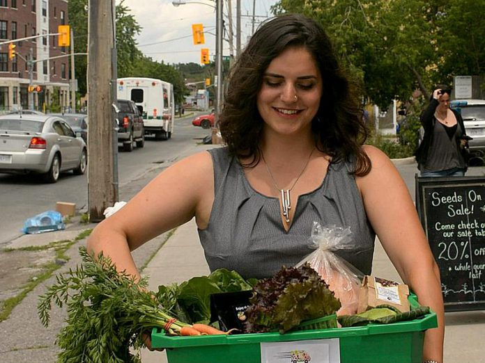 A customer picking up her order from Locavorest, an online farmers' market carrying items from more than 25 local producters. As of May 25, 2018, in addition to picking up orders, customers can now arrange for home delivery within the City of Peterborough. (Photo courtesy of Innovation Cluster)