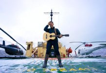"""Musician Danny Michel on the deck of the legendary Soviet-era Russian icebreaker Kapitan Khlebnikov during an 18-day arctic expedition, where he wrote and recorded all the songs on his award-winning 2017 album """"Khlebnikov"""". Michel performs at the Market Hall in Peterborough on May 27, 2018. (Photo courtesy of Danny Michel)"""