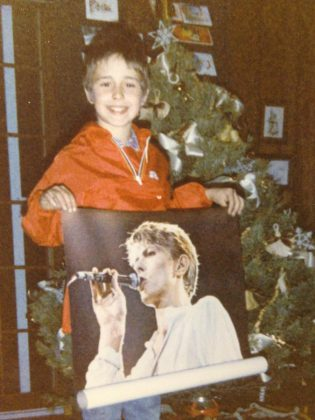A lifelong David Bowie fan, 10-year-old Danny Michel receives a Bowie poster for Christmas. (Photo courtesy of Danny Michel)