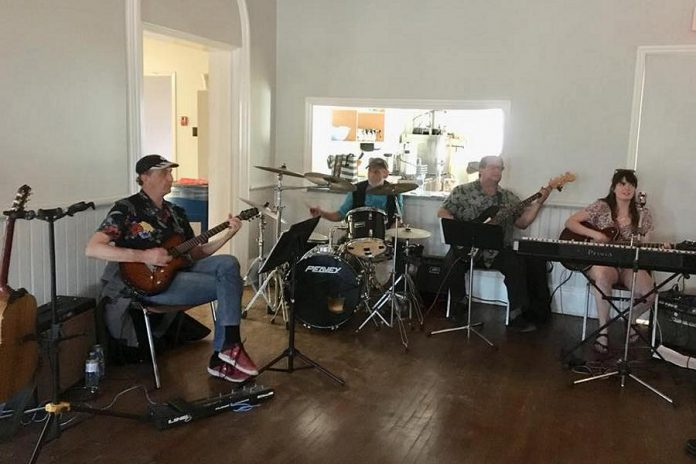 A band of local musicians (Ken Tuck,  Mac Palmer, and Tom Batten), pictured with musical director Bethany Brown, will perform music from Pink Floyd during the production. (Photo: Ida Brown)